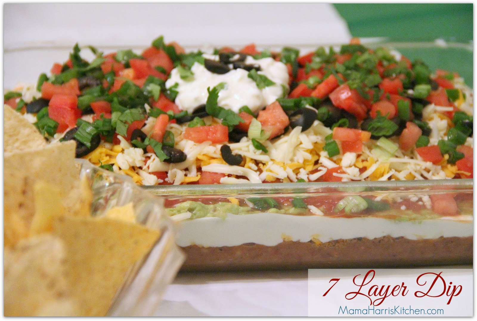 """7 layer Dip, perfect for the Big Day! Part of Mama Harris' Kitchen 3 """"Must-Have"""" Foods for the Big Game!"""
