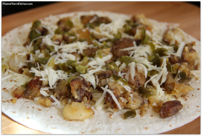 On top of one tortilla, sprinkle abotu 1/3 of the cheese, top with ...